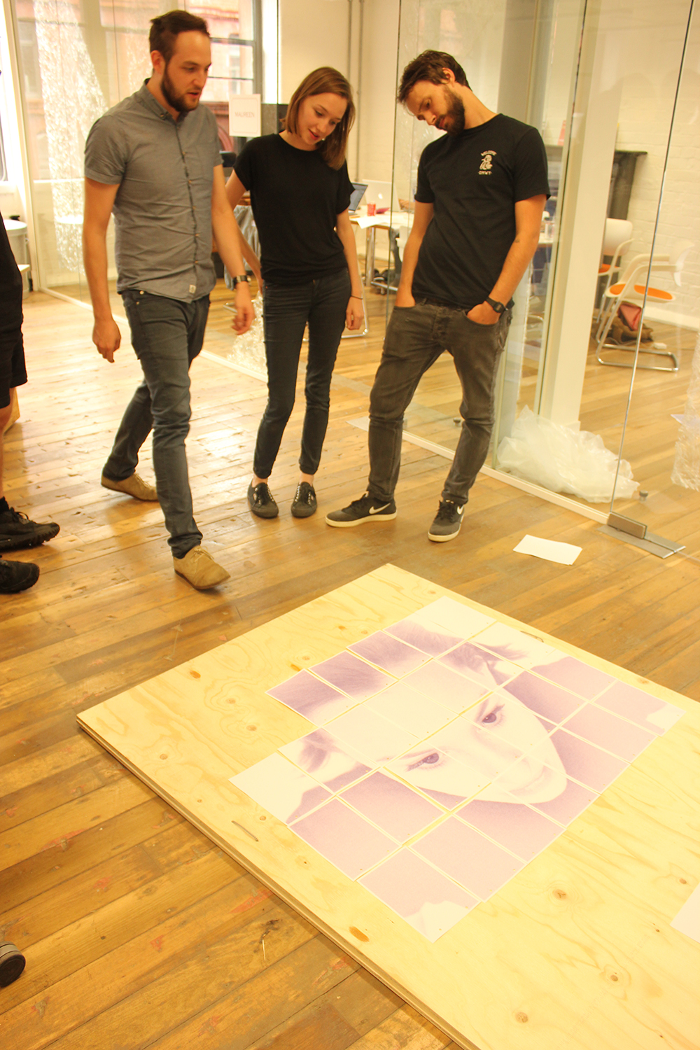 (L-R) Dan, Liv and Joel examine the latter's piece during the test print run